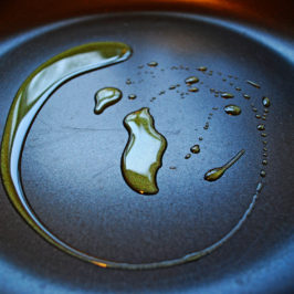 Swirl of cooking oil on fry pan